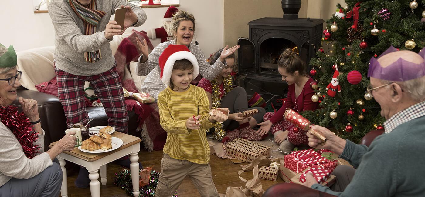 Family pulling Christmas cracker